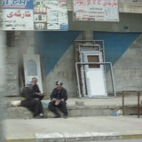 Men Outside A Shop In The Kurdish Town Of Harir